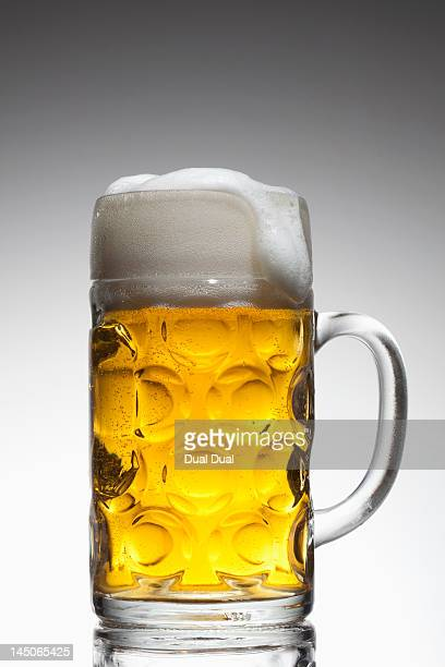 A glass mug of beer