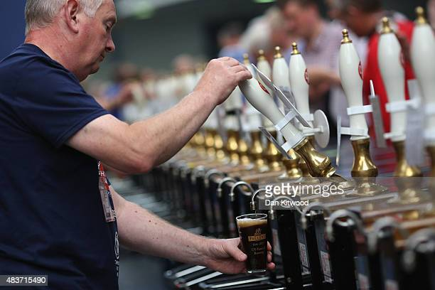 A glass of Ale is poured at the CAMRA Great British Beer festival at Olympia London exhibition centre on August 12 2015 in London England The five...