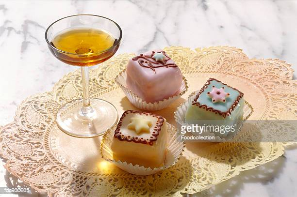 A glass of Amaretto with petit four
