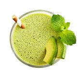 Glass of avocado smoothie with drinking straw and mint leaves  isolated on white background, top view
