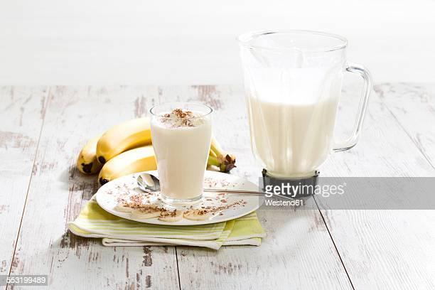 Glass of banana milkshake with whipped cream and chocolate granules
