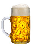 big glass of bavarian lager beer isolated over white background