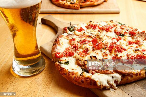 Glass of beer and a freshly baked pizza
