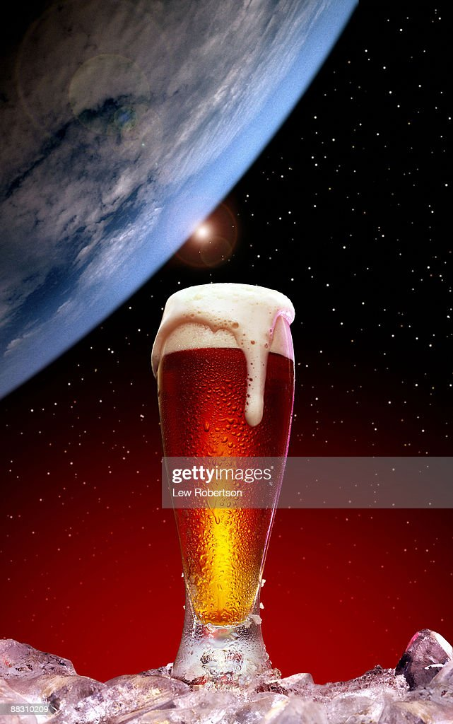 Glass of beer and blue moon : Stock Photo