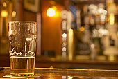 Glass of beer on bar counter top