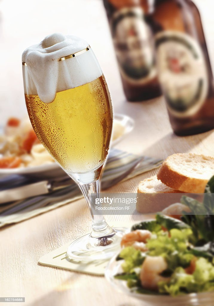 Glass Of beer, salad and beer bottles : Stock Photo