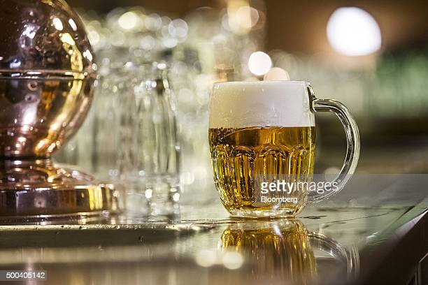 A glass of beer sits on the restaurant bar at the Pilsner Urquell brewery operated by SABMiller Plc in Plzen Czech Republic on Monday Dec 7 2015...