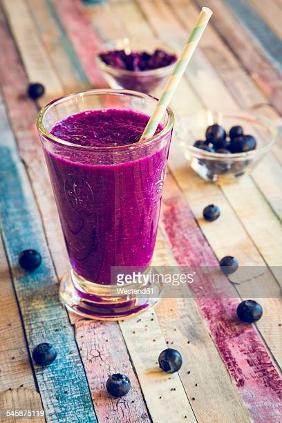 Glass of blueberry beetroot smoothie with chia seeds