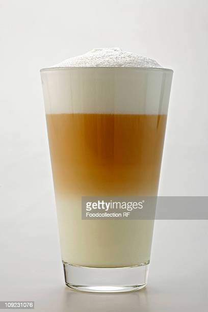 Glass of caff latte, close-up