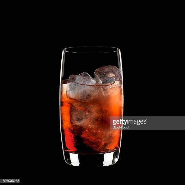 A glass of Campari Soda with ice cubes