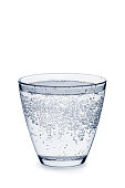 Glass of carbonated water with bubbles isolated on white background