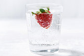 glass of carbonated water with fresh strawberries, horizontal