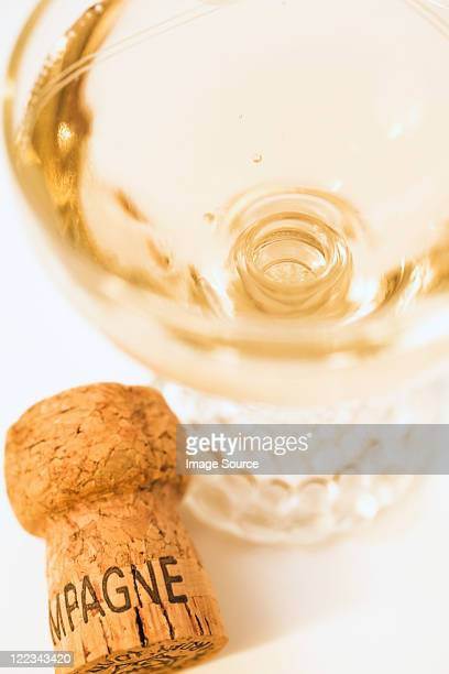 Glass of champagne and cork, close up