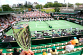 Glass of champagne and wide shot of  the ASB Classic Tennis tournament woman's Finals in Auckland. 7 January 2006