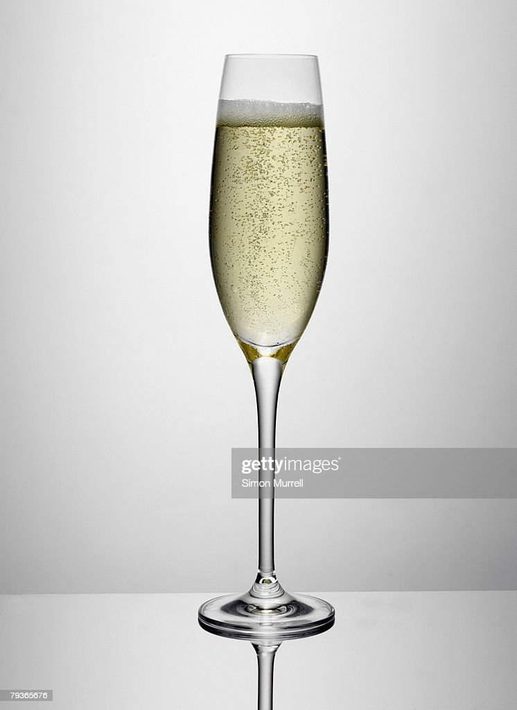 Glass of champagne indoors : Stock Photo