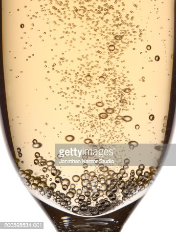Glass of champagne with bubbles, close-up
