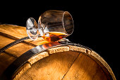 Glass of cognac on the vintage barrel.