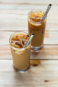 homemade cold coffee with stainless stell straw on wooden table background.