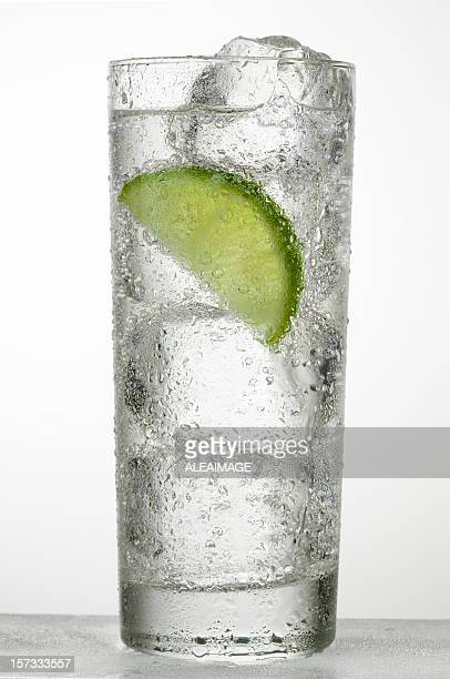 A glass of cold water with a slice of lime