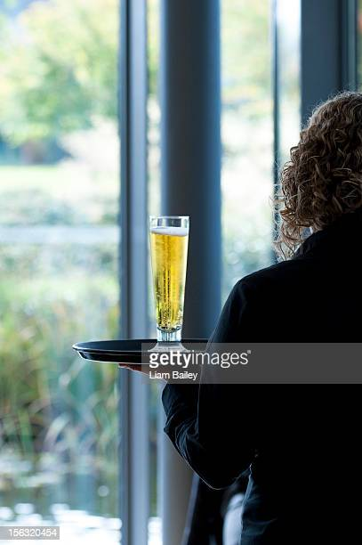 Glass of cool beer on a tray