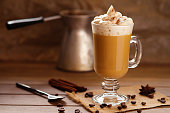 Photography of a glass of cup coffee with cream