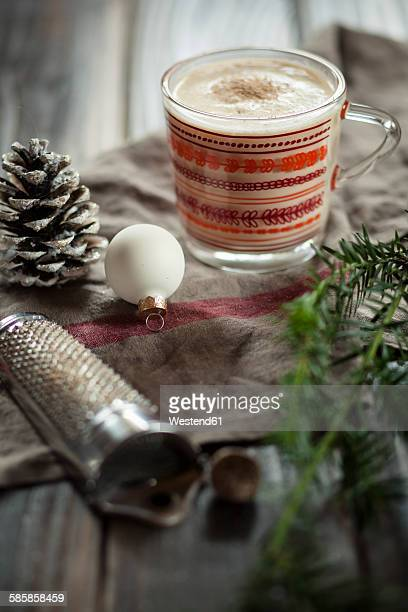 Glass of eggnogg spiced with nutmeg