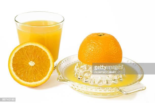 Glass of fresh orange and orange juiced.