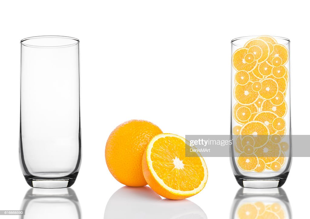 Glass of healthy organic oranges inside on white : Stock Photo