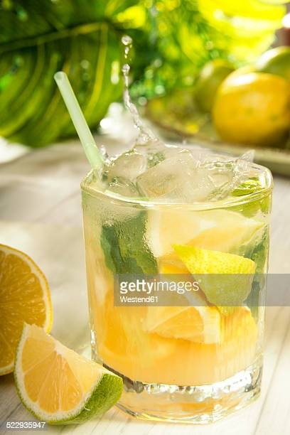 Glass of home made lemonade splash with slices of lemon