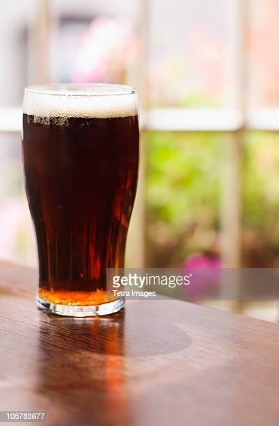 Glass of Irish ale in pub