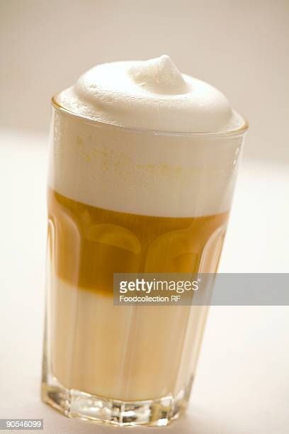Glass of latte macchiato, close up