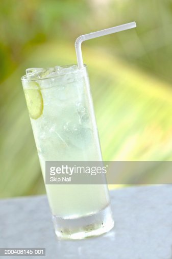Glass of lime juice with straw