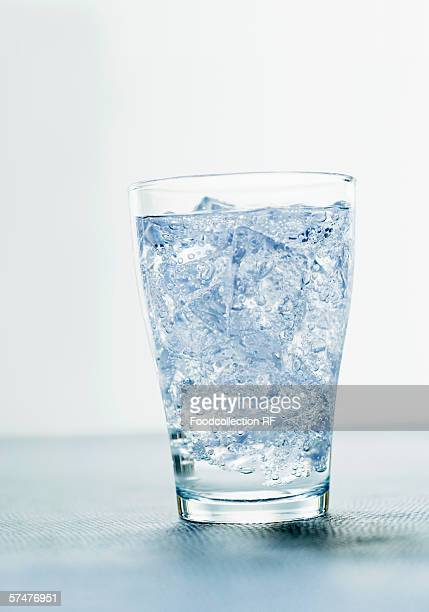 Glass of mineral water with ice cubes