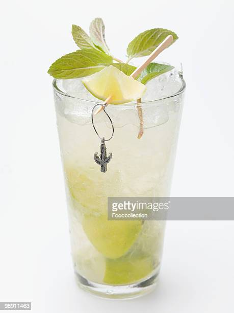 Glass of mojito with lime and mint, close-up