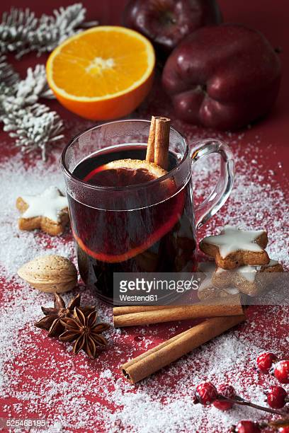 Glass of mulled wine with slice of orange and cinnamon stick