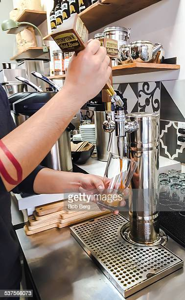 Santa Monica Ca February 5 2015 A glass of nitro coffee from the tap being poured at the Lo/Cal Coffee Market in Santa Monica