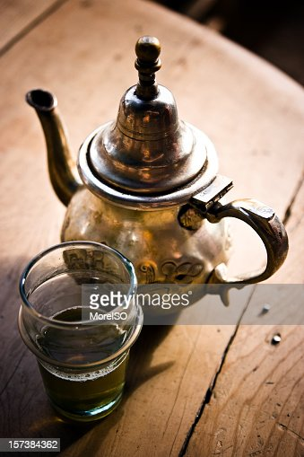 Glass Of North African Green Tea With Pot Wood Background ...