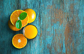 Glass of orange juice from above on blue grunge vintage wood table. Empty ready for your orange juice, fruit product display or montage.