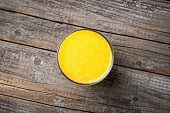 Glass of orange juice on an old wooden background. Close up