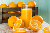 Glass of orange juice with oranges