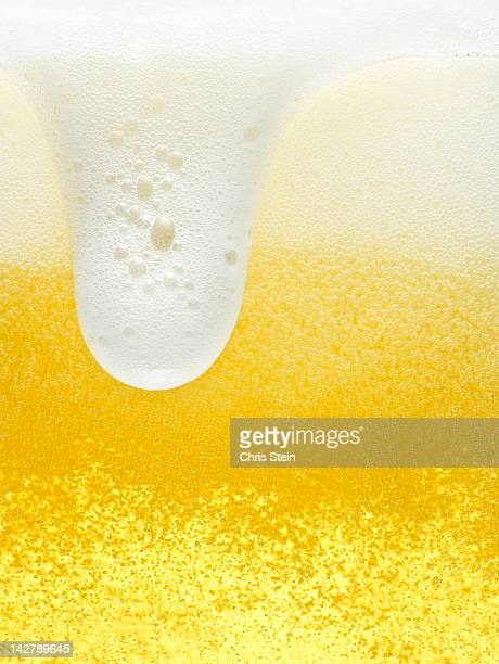 Glass of overflowing beer foam