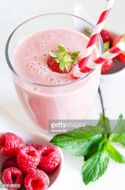 Glass of raspberry strawberry smoothie