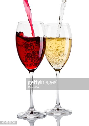 Glass of red and white wine pouring from bottle : Stock Photo