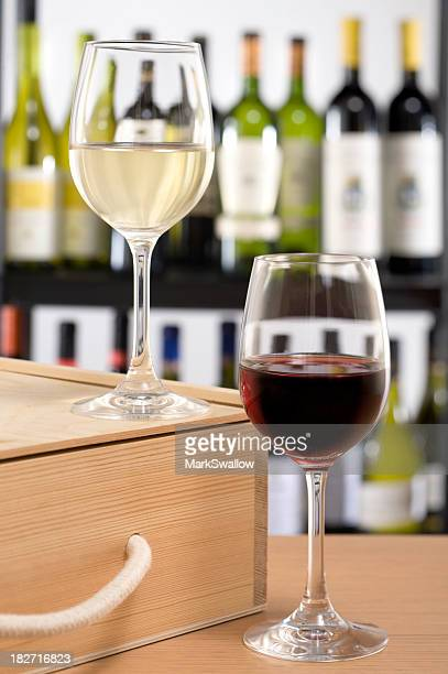 Glass of red and white wine side by side