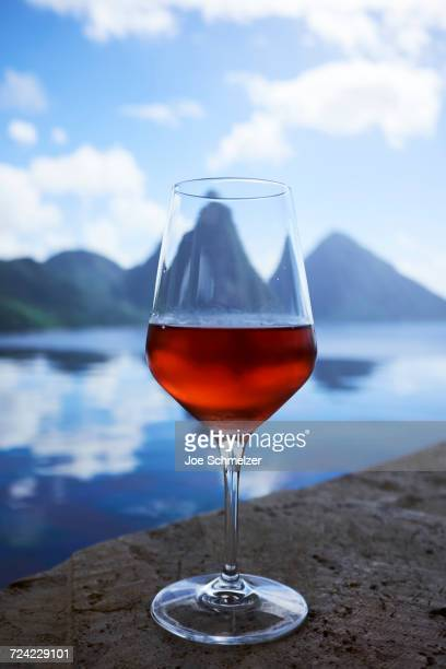 Glass of rose wine overlooking the Pitons, Saint Lucia, Caribbean