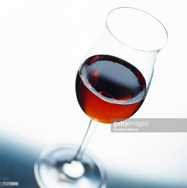 A glass of sherry, photographed from above, close-up.