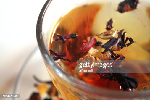 Glass of tea in rosehip leaves : Stock Photo
