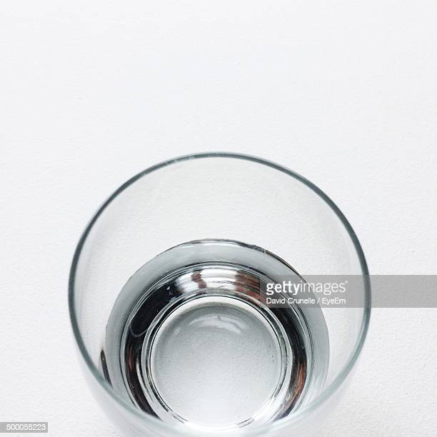 Glass of water over white background