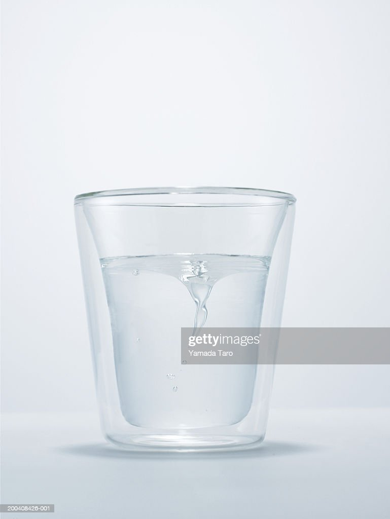 Glass of water with small whirlpool : Stock Photo
