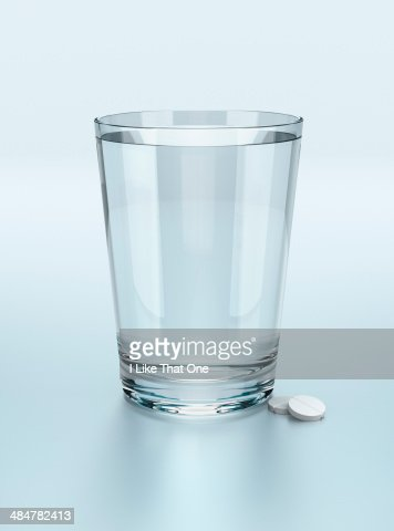 Glass of water with two tablets
